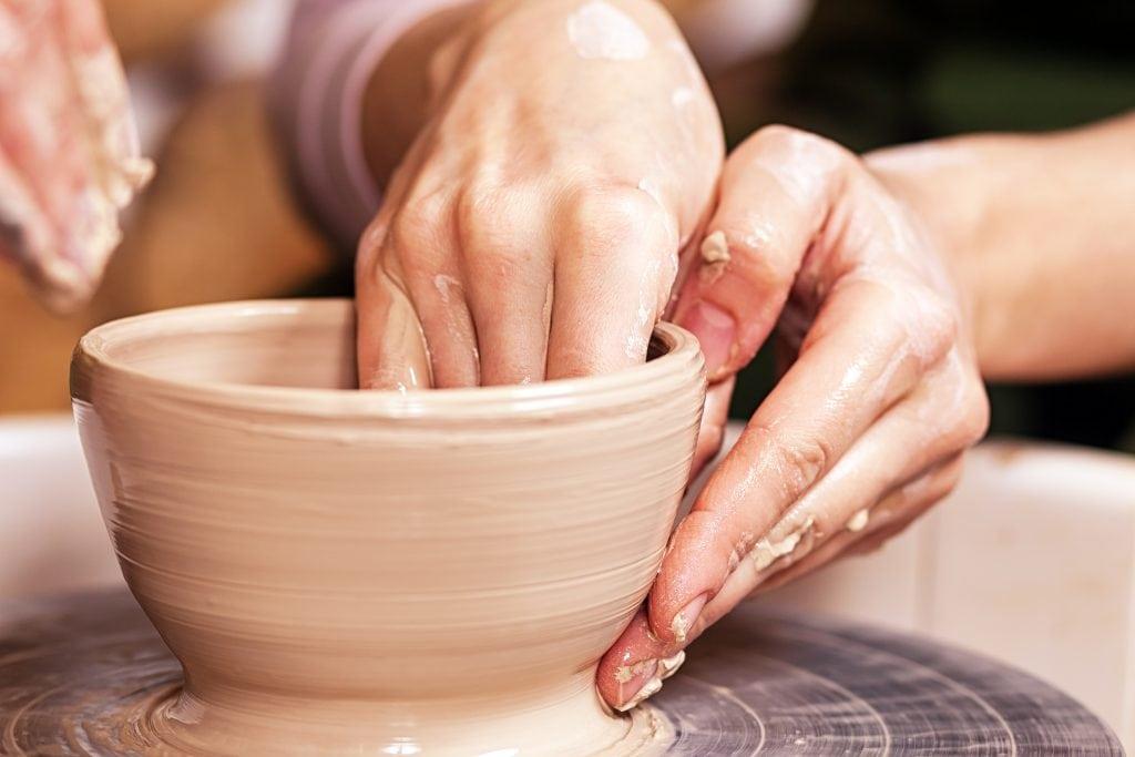 Close-up of a woman potter sclulpt clay
